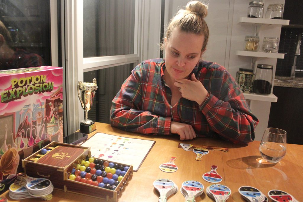 Rachel playing potion explosion